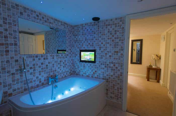 There is a whirlpool bath  big enough for two   multifunction shower  20 quot  Aqua vision bathroom HD LCD TV  bluetooth speakers built into the bath  mood. Honeymoon Cottages   Lake View   Millbrook Cottages
